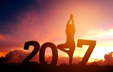 Silhouette young woman practicing yoga on 2017 new year