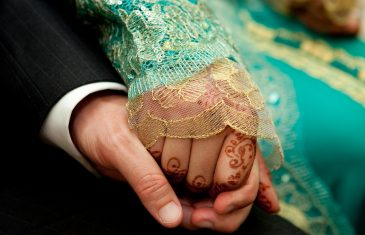 Close up of a Moroccan wedding couple's hands
