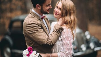 Stylish Loving wedding couple kissing and hugging in a pine fore